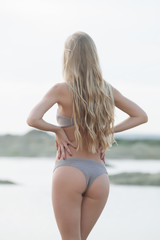 Girl in swimsuit at the sea