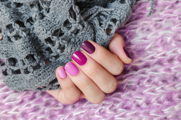 Pink nail design. Beautiful female hand with different shades of pink manicure