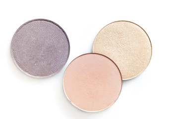 Beige and pink eye shadow or blusher isolated on white background