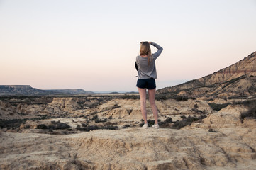 Young woman taking pictures of the desert // Spain