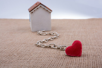 Model house and chain with a heart