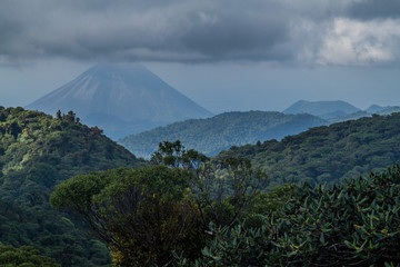 Cloud forest covering Reserva Biologica Bosque Nuboso Monteverde, Costa Rica. Arenal volcano in the background.