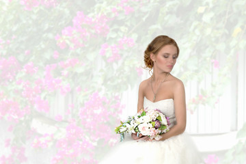 the bride with a bouquet  against the background of flowers