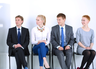 Group of business people sitting on chair in office . Group of business people