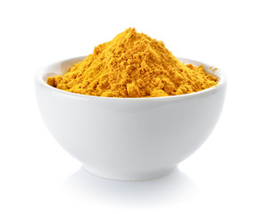 Turmeric powder in a bowl on white background
