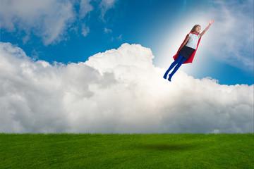 Superhero kid flying in dream concept