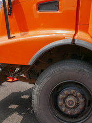 Big orange dump truck detail with tire