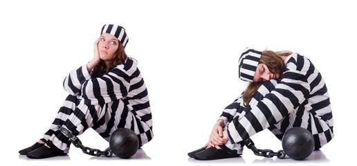 Prisoner in striped uniform on white