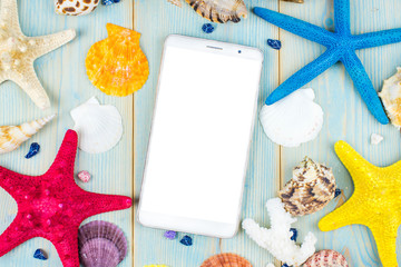 Empty display Smartphone on wooden table with starfish and shells. Top view with copy space