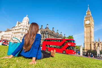 Zelfklevend Fotobehang Londen rode bus London city lifestyle woman relaxing in Westminster summer park, red bus and big ben tower. Urban girl outdoors.