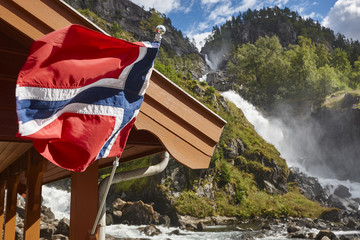 Norwegian twin waterfall. Norway flag. Latefossen.