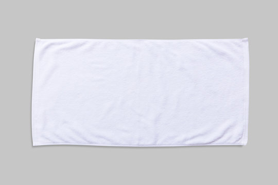 White beach towel mock up isolated with clipping path on grey background, flat lay top view