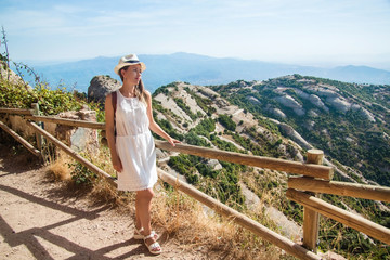 Young woman hiking in Montserrat mountain and enjoying the view