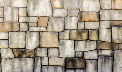 Stone wall texture background, pattern natural color of modern style design decorative uneven cracked real stone wall surface with cement