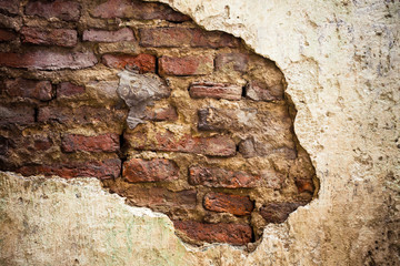 Empty Old Brick Wall Texture.Cracked concrete vintage stonewall background, Destroyed Concrete,Shabby Building Facade With Damaged Plaster.