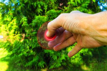 spinner in hand