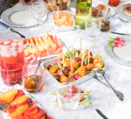 Table set for lunch in the garden, with food very colorful