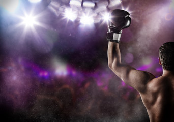 Close-up of man boxer with raised hand in victory gesture