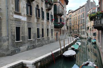 Canals of Venice with pleasure boats and gondolas, Italy