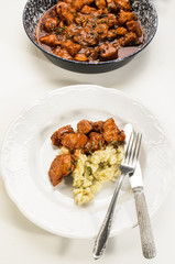 hungarian style chicken goulash with dumplings on a plate
