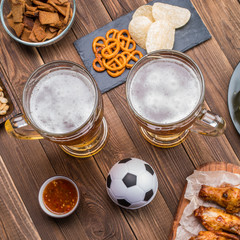 Appetizers and beer on the table for watch the football match.