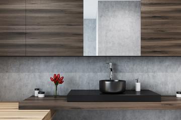 Concrete bathroom, mirror and sink close up