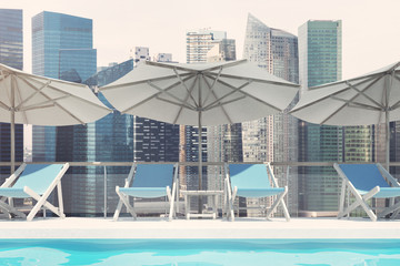Blue deck chairs, umbrellas, cityscape