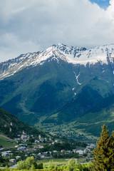 Mountain village in the background of snow mountains, Georgia