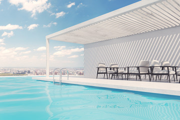 Swimming pool with white armchairs, clouds