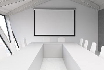 Attic meeting room, white ceiling, poster