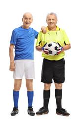 Elderly soccer player and a goalkeeper