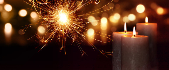 Background with candles and sparkling lights Wall mural