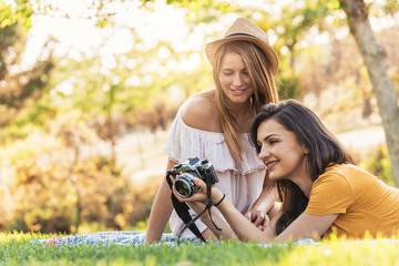 Photographer showing a picture to her friend.
