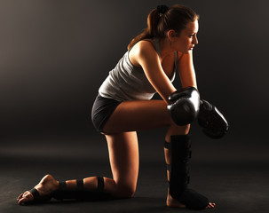 Garden Poster Martial arts Young attractive female martial arts fighter.Resting after hard training.
