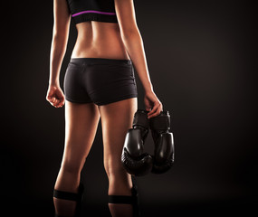 Foto auf AluDibond Kampfsport Young female martial arts fighter.She holding boxing gloves.Rear view of torso.