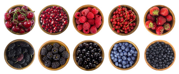 Black-blue and red berries isolated on white background. Collage of different fruits and berries. Blueberry, mulberry, bilberry, blackberry, cherry, strawberry, currant, pomegranate and raspberry.