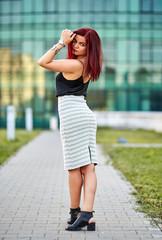 Redhead lady in urban environment