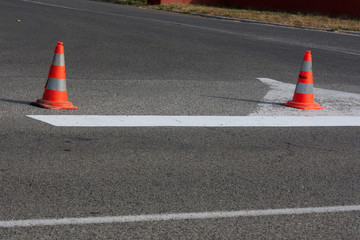 Two road construction cones standing