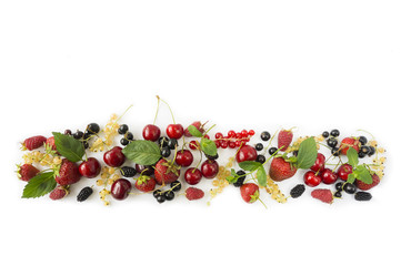 Ripe strawberries, redcurrants, blackcurrants, mulberries, raspberries and cherries on white background. Berries at border of image with copy space for text. .
