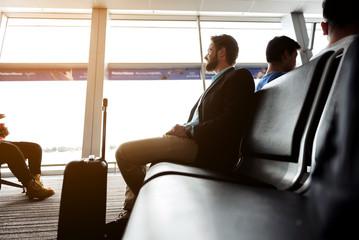 Joyful businessman is travelling alone