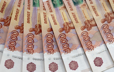Row of Russian 5000 rubles, business background