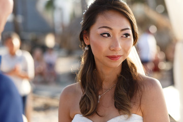 Beautiful bride cries during the ceremony on the beach