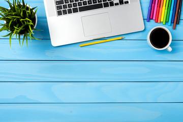 Office desktop with modern laptop. Business background