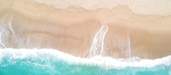 Aerial view of sandy beach and ocean with waves Wall mural
