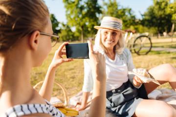 Cheerful senior woman posing in the picnic