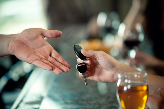 Bar: Car Keys Being Handed Across Bar