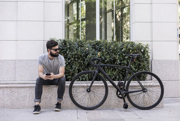 Young man with his bike