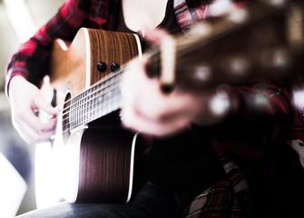 Close-up girl holding guitar.