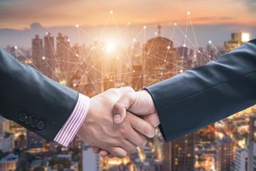 Partners shaking hands . Mixed media