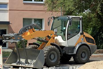 Loader works on road reconstruction